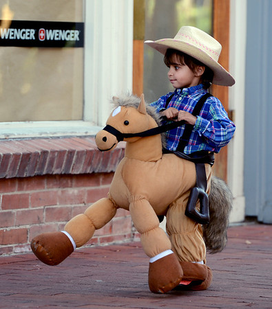 "Kiran Sodha, 2, became a horse during the Munchkin Masquerade.<br /> Over 80 downtown businesses provided treats to kids of all ages at the annual Munchkin Masquerade.<br /> For more photos and a video of the Munchkin Masquerade, go to  <a href=""http://www.dailycamera.com"">http://www.dailycamera.com</a>.<br /> Cliff Grassmick  / October 31, 2012"