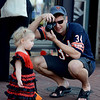 "Brendan Klein takes a photo of his daughter, Davie, during the Munchkin Masquerade.<br /> Over 80 downtown businesses provided treats to kids of all ages at the annual Munchkin Masquerade.<br /> For more photos and a video of the Munchkin Masquerade, go to  <a href=""http://www.dailycamera.com"">http://www.dailycamera.com</a>.<br /> Cliff Grassmick  / October 31, 2012"