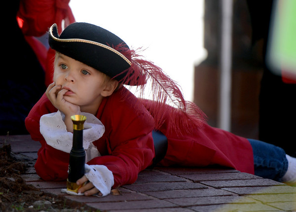 "Silas Besel, 5, dreams of his life as a pirate during the Munchkin Masquerade on Wednesday.<br /> Over 80 downtown businesses provided treats to kids of all ages at the annual Munchkin Masquerade.<br /> For more photos and a video of the Munchkin Masquerade, go to  <a href=""http://www.dailycamera.com"">http://www.dailycamera.com</a>.<br /> Cliff Grassmick  / October 31, 2012"