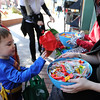 "Reece Witte, left, gets candy from Stephanie Schindheln of the Boulder Book Store.<br /> Over 80 downtown businesses provided treats to kids of all ages at the annual Munchkin Masquerade.<br /> For more photos and a video of the Munchkin Masquerade, go to  <a href=""http://www.dailycamera.com"">http://www.dailycamera.com</a>.<br /> Cliff Grassmick  / October 31, 2012"