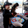 "Arvin Rezvani, 5,, left, gets candy from Stephanie Schindheln of the Boulder Book Store.<br /> Over 80 downtown businesses provided treats to kids of all ages at the annual Munchkin Masquerade.<br /> For more photos and a video of the Munchkin Masquerade, go to  <a href=""http://www.dailycamera.com"">http://www.dailycamera.com</a>.<br /> Cliff Grassmick  / October 31, 2012"