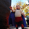 "Owen Ritter, 20-months, is ready to climb the water fountain rock as a super hero.<br /> Over 80 downtown businesses provided treats to kids of all ages at the annual Munchkin Masquerade.<br /> For more photos and a video of the Munchkin Masquerade, go to  <a href=""http://www.dailycamera.com"">http://www.dailycamera.com</a>.<br /> Cliff Grassmick  / October 31, 2012"