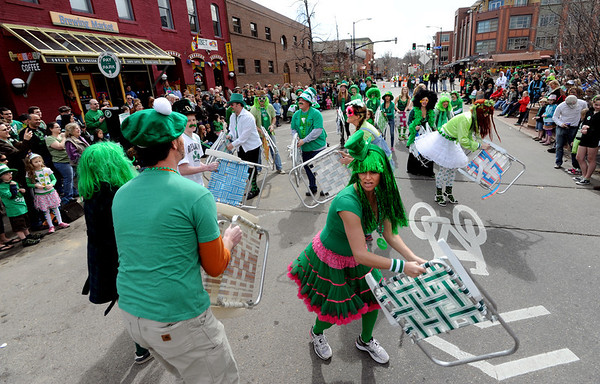 """Matt Cutter, bottom left, leads the Paddy O'Furniture Drill team in a difficult formation during the parade.<br /> The 2012 World's Shortest St Patrick's Day Parade was held in front of Conor O'Neill's off the Pearl Street Mall in Boulder.<br /> For more photos and a video, go to  <a href=""""http://www.dailycamera.com"""">http://www.dailycamera.com</a>.<br /> Cliff Grassmick / March 11, 2012"""