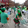"Matt Cutter, bottom left, leads the Paddy O'Furniture Drill team in a difficult formation during the parade.<br /> The 2012 World's Shortest St Patrick's Day Parade was held in front of Conor O'Neill's off the Pearl Street Mall in Boulder.<br /> For more photos and a video, go to  <a href=""http://www.dailycamera.com"">http://www.dailycamera.com</a>.<br /> Cliff Grassmick / March 11, 2012"