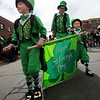 "Blake and Grant Niemann, carry the parade colors with help from their dad, Eric, during the parade.<br /> The 2012 World's Shortest St Patrick's Day Parade was held in front of Conor O'Neill's off the Pearl Street Mall in Boulder.<br /> For more photos and a video, go to  <a href=""http://www.dailycamera.com"">http://www.dailycamera.com</a>.<br /> Cliff Grassmick / March 11, 2012"