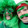 "Beau Evans, left, and Jesse Bacardi, are as green as it gets before the parade.<br /> The 2012 World's Shortest St Patrick's Day Parade was held in front of Conor O'Neill's off the Pearl Street Mall in Boulder.<br /> For more photos and a video, go to  <a href=""http://www.dailycamera.com"">http://www.dailycamera.com</a>.<br /> Cliff Grassmick / March 11, 2012"