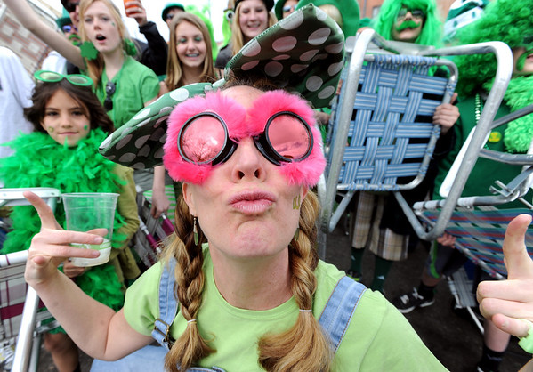 "Jodi Smith, of the Paddy O'Furniture Drill Team, has a kiss for the camera during the team picture.<br /> The 2012 World's Shortest St Patrick's Day Parade was held in front of Conor O'Neill's off the Pearl Street Mall in Boulder.<br /> For more photos and a video, go to  <a href=""http://www.dailycamera.com"">http://www.dailycamera.com</a>.<br /> Cliff Grassmick / March 11, 2012"