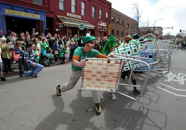 """Matt Cutter leads the Paddy O'Furniture Drill team in some razzle dazzle  during the parade.<br /> The 2012 World's Shortest St Patrick's Day Parade was held in front of Conor O'Neill's off the Pearl Street Mall in Boulder.<br /> For more photos and a video, go to  <a href=""""http://www.dailycamera.com"""">http://www.dailycamera.com</a>.<br /> Cliff Grassmick / March 11, 2012"""