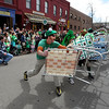 "Matt Cutter leads the Paddy O'Furniture Drill team in some razzle dazzle  during the parade.<br /> The 2012 World's Shortest St Patrick's Day Parade was held in front of Conor O'Neill's off the Pearl Street Mall in Boulder.<br /> For more photos and a video, go to  <a href=""http://www.dailycamera.com"">http://www.dailycamera.com</a>.<br /> Cliff Grassmick / March 11, 2012"