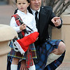 "Tom Johnson points out some things to his son, Fin, 4, before the parade.<br /> The 2012 World's Shortest St Patrick's Day Parade was held in front of Conor O'Neill's off the Pearl Street Mall in Boulder.<br /> For more photos and a video, go to  <a href=""http://www.dailycamera.com"">http://www.dailycamera.com</a>.<br /> Cliff Grassmick / March 11, 2012"