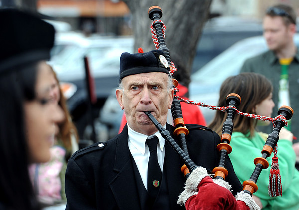 "Bill McCulloch of the Centennial State Pipes and Drums is on the pipes during a warm up.<br /> The 2012 World's Shortest St Patrick's Day Parade was held in front of Conor O'Neill's off the Pearl Street Mall in Boulder.<br /> For more photos and a video, go to  <a href=""http://www.dailycamera.com"">http://www.dailycamera.com</a>.<br /> Cliff Grassmick / March 11, 2012"