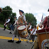 "Nick Meadows, right,  of the Northern Colorado  Fife and Drum Corp, plays a drum in the parade. <br /> The Niwot Rotary Club and the Niwot Business Association hosted the Niwot Fourth of July festival and parade on Sunday.<br /> For more photos of the parade, go to  <a href=""http://www.dailycamera.com"">http://www.dailycamera.com</a>.<br />  Cliff Grassmick / July 4, 2010"