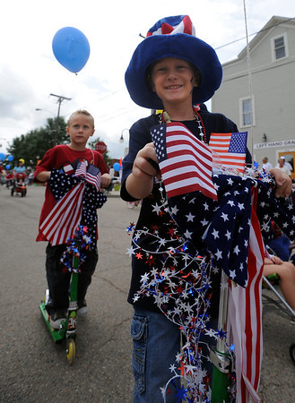 "Shea Prahl, right, and his twin brother Aidan, both 6, ride their scooters in the parade.<br /> The Niwot Rotary Club and the Niwot Business Association hosted the Niwot Fourth of July festival and parade on Sunday.<br /> For more photos of the parade, go to  <a href=""http://www.dailycamera.com"">http://www.dailycamera.com</a>.<br />  Cliff Grassmick / July 4, 2010"