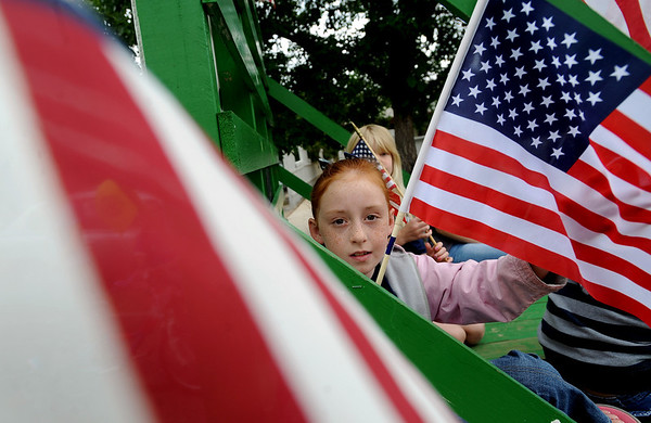 "Jenna Naeg, of the Niwot 4H, is surrounded by the red, white and blue on the Niwot Nifties float.<br /> The Niwot Rotary Club and the Niwot Business Association hosted the Niwot Fourth of July festival and parade on Sunday.<br /> For more photos of the parade, go to  <a href=""http://www.dailycamera.com"">http://www.dailycamera.com</a>.<br />  Cliff Grassmick / July 4, 2010"