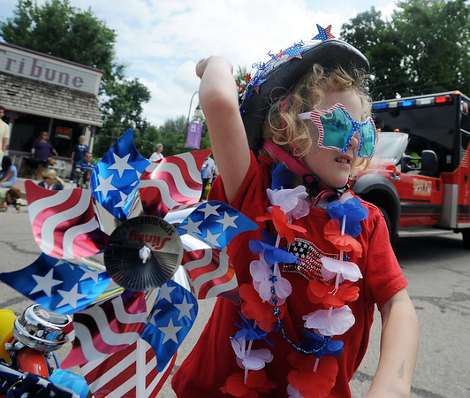 "Amber Boothby, 5, dressed for the holiday, throws candy to the crowd.<br /> The Niwot Rotary Club and the Niwot Business Association hosted the Niwot Fourth of July festival and parade on Sunday.<br /> For more photos of the parade, go to  <a href=""http://www.dailycamera.com"">http://www.dailycamera.com</a>.<br />  Cliff Grassmick / July 4, 2010"