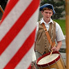 """B.J. Evans of the Northern Colorado Fife and Drum Corp, plays behind the US Flag.<br /> The Niwot Rotary Club and the Niwot Business Association hosted the Niwot Fourth of July festival and parade on Sunday.<br /> For more photos of the parade, go to  <a href=""""http://www.dailycamera.com"""">http://www.dailycamera.com</a>.<br />  Cliff Grassmick / July 4, 2010"""