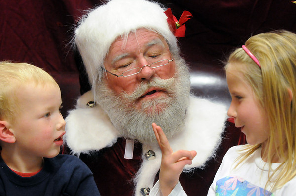 Santa listens to the wishes of Colin Womack, 3, left, and his sister Natalie, 6,  during the Holiday Tree Lighting Ceremony at the Broomfield City and County Building on Friday<br /> December 4, 2009<br /> Staff photo/David R. Jennings