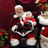 Santa holds 8 month-old Elias Eades as they pose for pictures by Elias's parents at the Holiday Tree Lighting Ceremony at the Broomfield City and County Building on Friday.<br /> December 4, 2009<br /> Staff photo/David R. Jennings