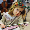 Sofia Calavitia, 5, waits for her turn to perform with the Suzuki Violin Students at the Holiday Tree Lighting Ceremony at the Broomfield City and County Building on Friday<br /> December 4, 2009<br /> Staff photo/David R. Jennings