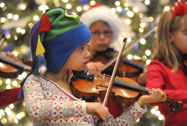 Amanda McIntyre, 6, plays with the Suzuki Violin Students at the Holiday Tree Lighting Ceremony at the Broomfield City and County Building on Friday.<br /> December 4, 2009<br /> Staff photo/David R. Jennings