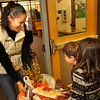 Tobey Bassoff, Principal at Ryan Elementary, left, gets help carrying a Thanksgiving basket from her son Noah, 5, and daughter Anna, 8, at Ryan Elementary, where the Ryan Elementary community came together to make Thanksgiving baskets for families in need, in Lafayette on Monday Nov. 19, 2012. DAILY CAMERA/ JESSICA CUNEO.