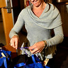 Lori Vantassel prepares Thanksgiving baskets and bags at Ryan Elementary, where the Ryan Elementary community came together to make Thanksgiving baskets for families in need, in Lafayette on Monday Nov. 19, 2012. DAILY CAMERA/ JESSICA CUNEO.
