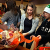 Melia Syed, center, and her son Konner prepare a Thanksgiving basket at Ryan Elementary, where the Ryan Elementary community came together to make Thanksgiving baskets for families in need, in Lafayette on Tuesday Nov. 20, 2012. DAILY CAMERA/ JESSICA CUNEO.