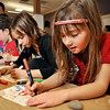 Kindergardener Carl Travis, left, Haley Maddocks, fourth grade, and Zoe Maddocks, first grade, make Thanksgiving cards at Ryan Elementary, where the Ryan Elementary community came together to make Thanksgiving baskets for families in need, in Lafayette on Monday Nov. 19, 2012. DAILY CAMERA/ JESSICA CUNEO.
