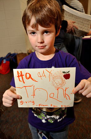Alder Jackson Cahill shows off his Thanksgiving card at Ryan Elementary, where the Ryan Elementary community came together to make Thanksgiving baskets for families in need, in Lafayette on Monday Nov. 19, 2012. DAILY CAMERA/ JESSICA CUNEO.