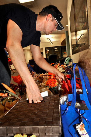 Andy Castellano sorts through Thanksgiving baskets at Ryan Elementary, where the Ryan Elementary community came together to help families in need for Thanksgiving, in Lafayette on Monday Nov. 19, 2012. DAILY CAMERA/ JESSICA CUNEO.