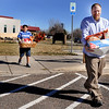 John Balenzuela, fifth grade, left, and Andy McCullough carry Thanksgiving food to the parking lot at Ryan Elementary, where the Ryan Elementary community came together to make Thanksgiving baskets for families in need, in Lafayette on Monday Nov. 19, 2012. DAILY CAMERA/ JESSICA CUNEO.