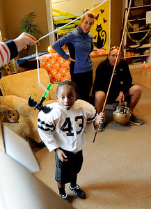Mo Thenell, 5, catches a prize at one of the games at the Kappa Kappa Gamma house on Sunday. The Kappa Kappa Gamma Society at the University of Colorado held the 7th annual Halloween House to benefit BoulderReads. For more photos at Kappa Kappa Gamma, go to www.dailycamera.com. Cliff Grassmick / October 28, 2012
