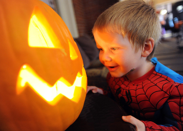 "Michael Fairchild, 2, gets eye to eye with a pumpkin at the Kappa Kappa Gamma house on Sunday.<br /> The Kappa Kappa Gamma Society at the University of Colorado held the 7th annual Halloween House to benefit BoulderReads.<br /> For more photos at Kappa Kappa Gamma, go to  <a href=""http://www.dailycamera.com"">http://www.dailycamera.com</a>.<br /> Cliff Grassmick / October 28, 2012"