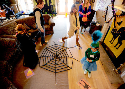 Kylie Pazol, left, and sister, Rylan, play one of the games with their parents, Todd and Erika, at the Kappa Kappa Gamma house on Sunday. The Kappa Kappa Gamma Society at the University of Colorado held the 7th annual Halloween House to benefit BoulderReads. For more photos at Kappa Kappa Gamma, go to www.dailycamera.com. Cliff Grassmick / October 28, 2012