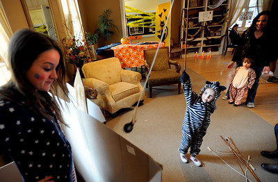 Callie Marks, 4, fishes for a prize with help from Michelle Levy,  at one of the games at the Kappa Kappa Gamma house on Sunday. The Kappa Kappa Gamma Society at the University of Colorado held the 7th annual Halloween House to benefit BoulderReads. For more photos at Kappa Kappa Gamma, go to www.dailycamera.com. Cliff Grassmick / October 28, 2012