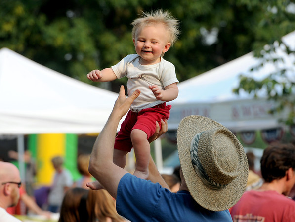 "Teegan Williams, 11-months, has fun dancing with his dad, Sam, at the Lafayette July 4th Community Celebration on Wednesday at Waneka Lake Park.<br /> For more photos and a video of the celebration, go to  <a href=""http://www.dailycamera.com"">http://www.dailycamera.com</a>.<br /> Cliff Grassmick / July 4, 2012"
