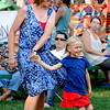 "Jane Rosenberg and her daughter, Casey, dance to the music of  Chris Daniels and the Kings  at the Lafayette July 4th Community Celebration on Wednesday at Waneka Lake Park.<br /> For more photos and a video of the celebration, go to  <a href=""http://www.dailycamera.com"">http://www.dailycamera.com</a>.<br /> Cliff Grassmick / July 4, 2012"