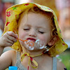 "Sarah McCowen, 2, visiting from Minnesota, tries to blow bubbles  at the Lafayette July 4th Community Celebration on Wednesday at Waneka Lake Park.<br /> For more photos and a video of the celebration, go to  <a href=""http://www.dailycamera.com"">http://www.dailycamera.com</a>.<br /> Cliff Grassmick / July 4, 2012"