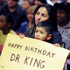 "Ivone Bagley and her son, Michael, listens to speakers during the ""All Cultures, One Voice,"" celebration  of the birthday of Martin Luther King on Sunday in Longmont.<br /> For more photos and a video of the march, go to  <a href=""http://www.dailycamera.com"">http://www.dailycamera.com</a>.<br /> January 15, 2012 / Cliff Grassmick"