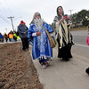 "Nizhoni Encina-Serrano, 3, right,  leads a celebration march for Martin Luther King on Sunday in Longmont.<br /> For more photos and a video of the march, go to  <a href=""http://www.dailycamera.com"">http://www.dailycamera.com</a>.<br /> January 15, 2012 / Cliff Grassmick"