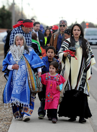 "Dora Esquibel, left, Xavier Encina-Serrano, his sister, Nizhoni, and mother, Miranda,were other members of the Apache Tribe of Colorado that marched in the All Cultures, One Voice Martin Luther King celebration in Longmont on Sunday.<br /> For more photos and a video of the march, go to  <a href=""http://www.dailycamera.com"">http://www.dailycamera.com</a>.<br /> January 15, 2012 / Cliff Grassmick"