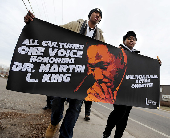 "Sergio King, left, and his sister, JoLyn, march with a Martin Luther King banner during the All Cultures, One Voice celebration on Sunday.<br /> For more photos and a video of the march, go to  <a href=""http://www.dailycamera.com"">http://www.dailycamera.com</a>.<br /> January 15, 2012 / Cliff Grassmick"