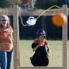 "Volunteer, Cheryl McMath, left, helps Emily Nenemaker, a 4th-grader, launch her pumpkin.<br /> Students at Coyote Ridge Elementary School in Broomfield, combine science with Halloween with pumpkin launchings on Wednesday.<br /> For a video  and more photos of the pumpkin launch at Coyote Ridge Elementary, go to  <a href=""http://www.broomfieldenterprise.com"">http://www.broomfieldenterprise.com</a>.<br /> Cliff Grassmick  / October 31, 2012"