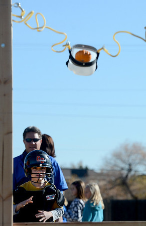 """Danny Gee, a 2nd-grader, launches her pumpkin at a target for class.<br /> Students at Coyote Ridge  Elementary School in Broomfield, combine science with Halloween with pumpkin launchings on Wednesday.<br /> For a video  and more photos of the pumpkin launch at Coyote Ridge Elementary, go to  <a href=""""http://www.broomfieldenterprise.com"""">http://www.broomfieldenterprise.com</a>.<br /> Cliff Grassmick  / October 31, 2012"""