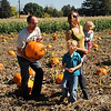 "Erik Paulsrud, left, carries the family pumpkin with Ulysses Paulsrud, Amy Hayes and daughter, Lillian Hayes, at Munson Farms on Saturday.<br /> For more photos of Munson Farms, go to  <a href=""http://www.dailycamera.com"">http://www.dailycamera.com</a><br /> Cliff Grassmick / September 29, 2012"