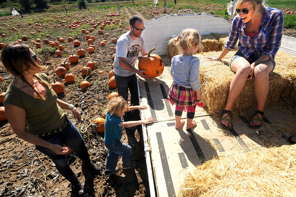 "Amy Hayes, left, gets on the wagon with Ulysses Paulsrud, Erik Paulson, Lillian Hayes and  Kristen Kron at Munson Farms on Saturday.<br /> For more photos of Munson Farms, go to  <a href=""http://www.dailycamera.com"">http://www.dailycamera.com</a><br /> Cliff Grassmick / September 29, 2012"
