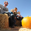 "Erik Paulsrud, left, rides with the family pumpkin with Ulysses Paulsrud, Amy Hayes and daughter, Lillian Hayes, at Munson Farms on Saturday.<br /> For more photos of Munson Farms, go to  <a href=""http://www.dailycamera.com"">http://www.dailycamera.com</a><br /> Cliff Grassmick / September 29, 2012"