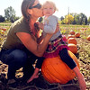 "Amy Hayes brings her daughter, Lillian, out to the Munson Farms pumpkin patch to pick out a pumpkin. Lillian appears to want to be somewhere else.<br /> For more photos of Munson Farms, go to  <a href=""http://www.dailycamera.com"">http://www.dailycamera.com</a><br /> Cliff Grassmick / September 29, 2012"