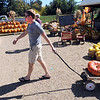 "Christian Ollier uses a wagon to bring in his haul at Munson Farms on Saturday.<br /> For more photos of Munson Farms, go to  <a href=""http://www.dailycamera.com"">http://www.dailycamera.com</a><br /> Cliff Grassmick / September 29, 2012"