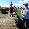 "Eric Steinat, right, of Littleton, watches his son, Emrick, walk on top of the hay bail maze.<br /> For more photos of pumpkin patches, go to  <a href=""http://www.dailycamera.com"">http://www.dailycamera.com</a><br /> Cliff Grassmick / October 2, 2011"